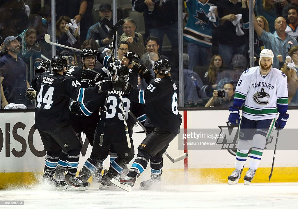 <a gi-track='captionPersonalityLinkClicked' href=/galleries/search?phrase=Patrick+Marleau&family=editorial&specificpeople=203165 ng-click='$event.stopPropagation()'>Patrick Marleau</a> #12 of the San Jose Sharks celebrates with <a gi-track='captionPersonalityLinkClicked' href=/galleries/search?phrase=Marc-Edouard+Vlasic&family=editorial&specificpeople=880807 ng-click='$event.stopPropagation()'>Marc-Edouard Vlasic</a> #44, <a gi-track='captionPersonalityLinkClicked' href=/galleries/search?phrase=Logan+Couture&family=editorial&specificpeople=809700 ng-click='$event.stopPropagation()'>Logan Couture</a> #39, Raffi Torres #13 and Justin Braun #61 after Marleau scored a third period goal against the Vancouver Canucks in Game Three of the Western Conference Quarterfinals during the 2013 NHL Stanley Cup Playoffs at HP Pavilion on May 5, 2013 in San Jose, California. The Sharks defeated the Canucks 5-2.