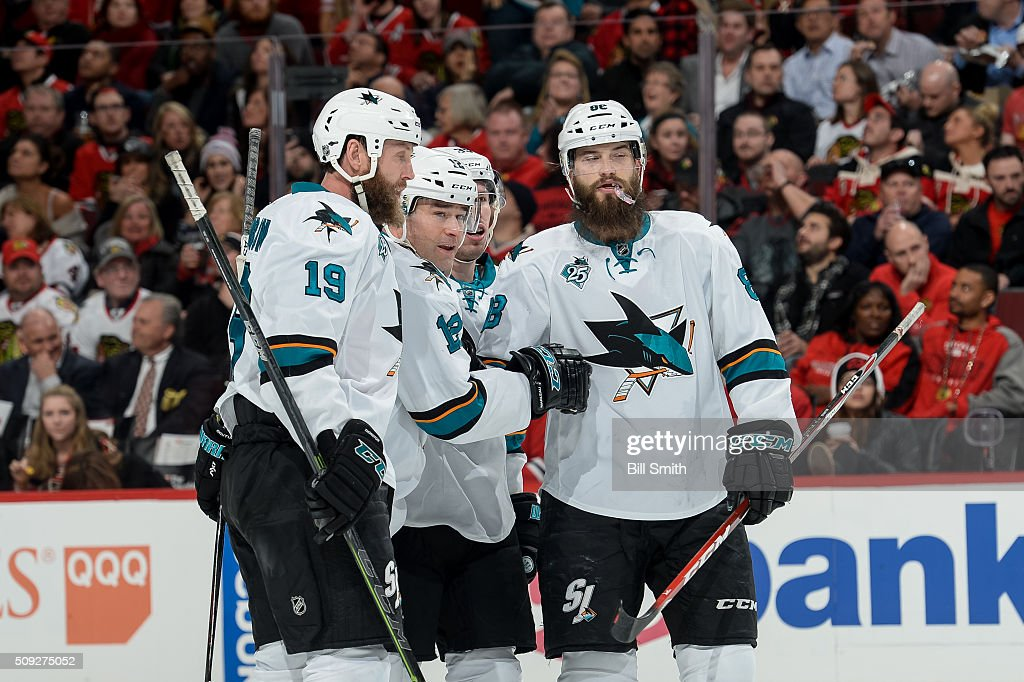 Patrick Marleau of the San Jose Sharks celebrates with teammates after scoring against the Chicago Blackhawks in the second period of the NHL game at...