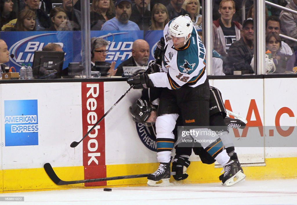 <a gi-track='captionPersonalityLinkClicked' href=/galleries/search?phrase=Patrick+Marleau&family=editorial&specificpeople=203165 ng-click='$event.stopPropagation()'>Patrick Marleau</a> #12 of the San Jose Sharks checks Mike Richards #10 of the Los Angeles Kings off the puck during the NHL game at Staples Center on March 16, 2013 in Los Angeles, California. The Kings defeated the Sharks 5-2.