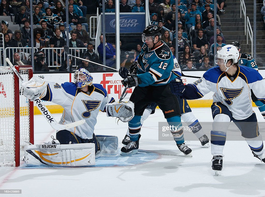 Patrick Marleau #12 of the San Jose Sharks creates traffic in front of the net against Jake Allen #34 of the St. Louis Blues during an NHL game on March 9, 2013 at HP Pavilion in San Jose, California.
