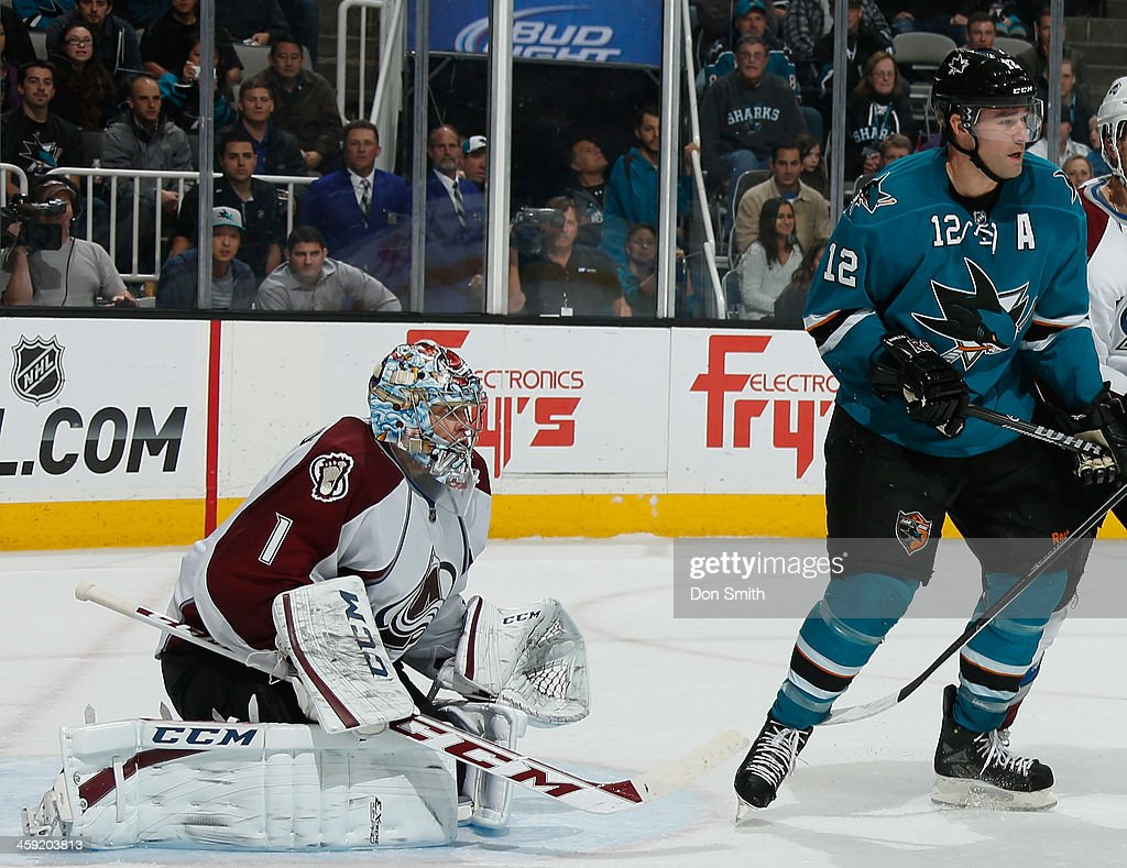 Patrick Marleau #12 of the San Jose Sharks crowds the net against Semyon Varlamov #1 of the Colorado Avalanche during an NHL game on December 23, 2013 at SAP Center in San Jose, California.
