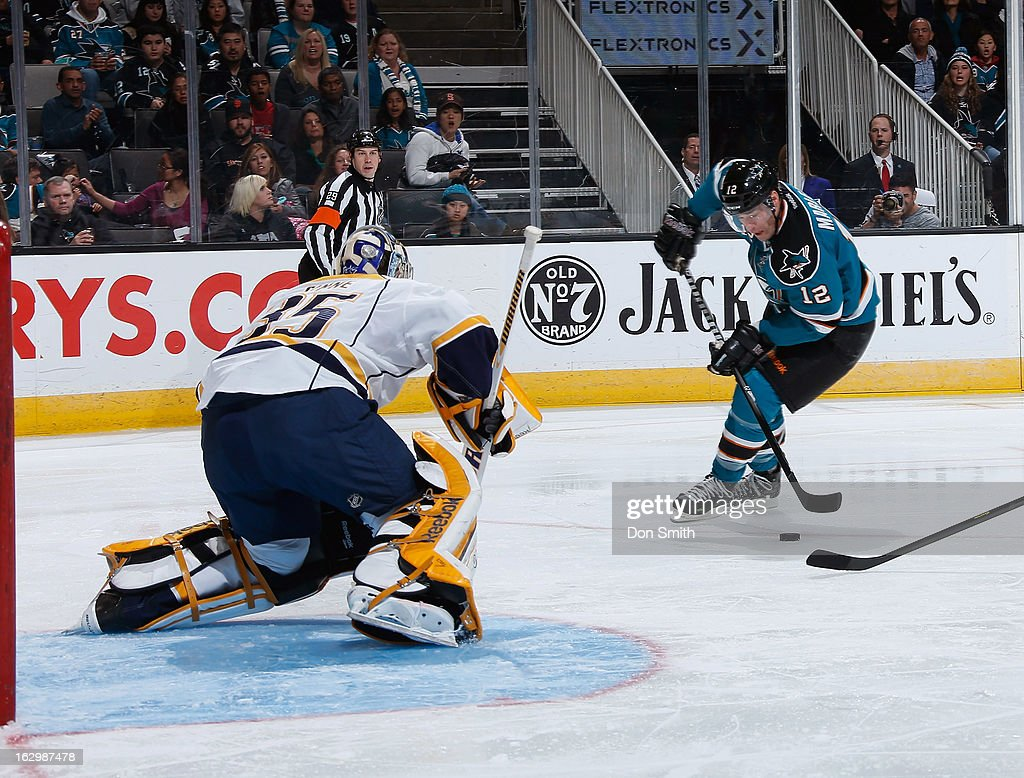 <a gi-track='captionPersonalityLinkClicked' href=/galleries/search?phrase=Patrick+Marleau&family=editorial&specificpeople=203165 ng-click='$event.stopPropagation()'>Patrick Marleau</a> #12 of the San Jose Sharks handles the puck against <a gi-track='captionPersonalityLinkClicked' href=/galleries/search?phrase=Pekka+Rinne&family=editorial&specificpeople=2118342 ng-click='$event.stopPropagation()'>Pekka Rinne</a> #35 of the Nashville Predators during an NHL game on March 2, 2013 at HP Pavilion in San Jose, California.