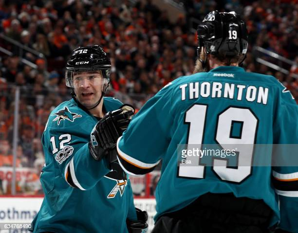Patrick Marleau of the San Jose Sharks is congratulated by teammate Joe Thornton after he scored in the third period against the Philadelphia Flyers...