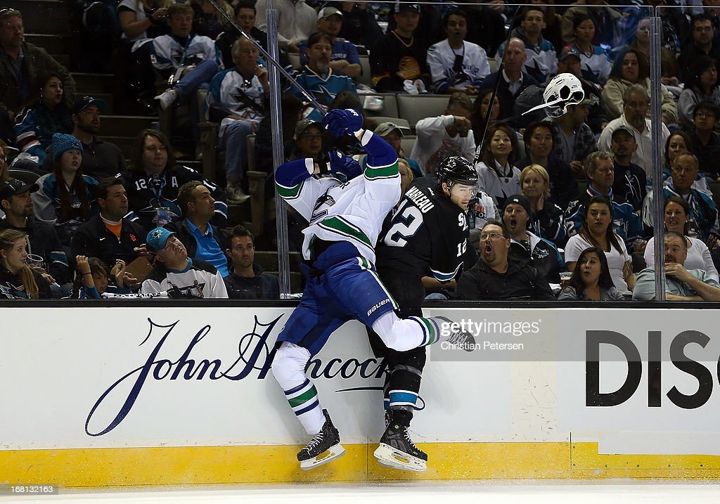 Patrick Marleau #12 of the San Jose Sharks lays a body check onto Ryan Kesler #17 of the Vancouver Canucks in the first period of Game Three of the Western Conference Quarterfinals during the 2013 NHL Stanley Cup Playoffs at HP Pavilion on May 5, 2013 in San Jose, California.