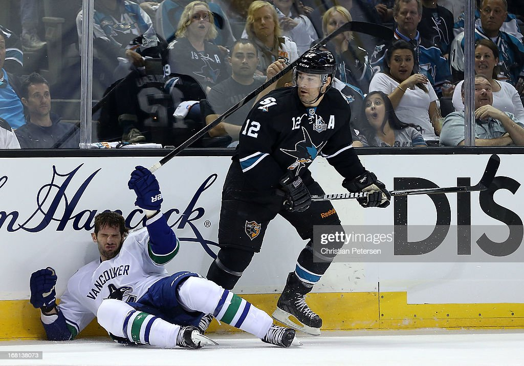 <a gi-track='captionPersonalityLinkClicked' href=/galleries/search?phrase=Patrick+Marleau&family=editorial&specificpeople=203165 ng-click='$event.stopPropagation()'>Patrick Marleau</a> #12 of the San Jose Sharks lays a body check onto <a gi-track='captionPersonalityLinkClicked' href=/galleries/search?phrase=Ryan+Kesler&family=editorial&specificpeople=206915 ng-click='$event.stopPropagation()'>Ryan Kesler</a> #17 of the Vancouver Canucks in the first period of Game Three of the Western Conference Quarterfinals during the 2013 NHL Stanley Cup Playoffs at HP Pavilion on May 5, 2013 in San Jose, California. The Sharks defeated the Canucks 5-2.