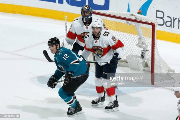 Patrick Marleau of the San Jose Sharks looks on along with Jason Demers and Roberto Luongo of the Florida Panthers at SAP Center at San Jose on...