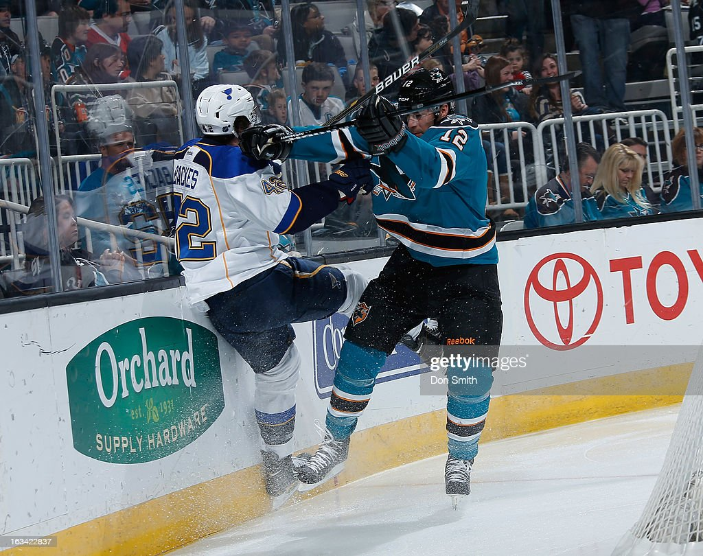 Patrick Marleau #12 of the San Jose Sharks puts a hit on David Backes #42 of the St. Louis Blues during an NHL game on March 9, 2013 at HP Pavilion in San Jose, California.