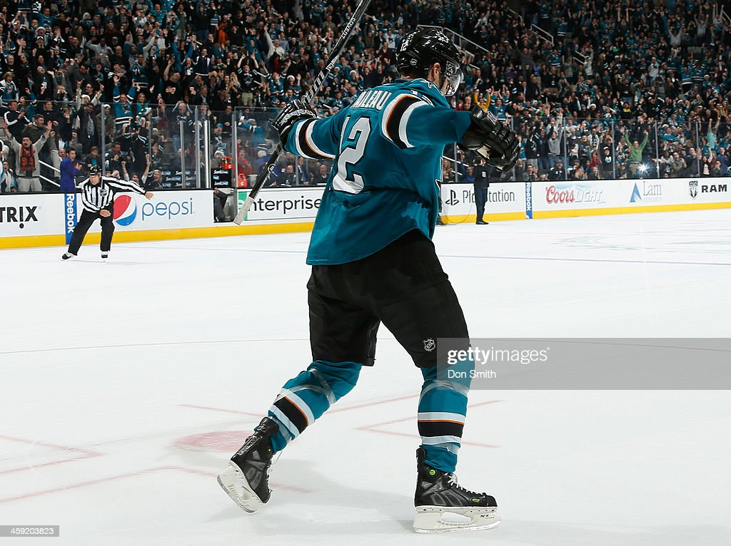 Patrick Marleau #12 of the San Jose Sharks scores the game winning goal in a shootout against the Colorado Avalanche during an NHL game on December 23, 2013 at SAP Center in San Jose, California.