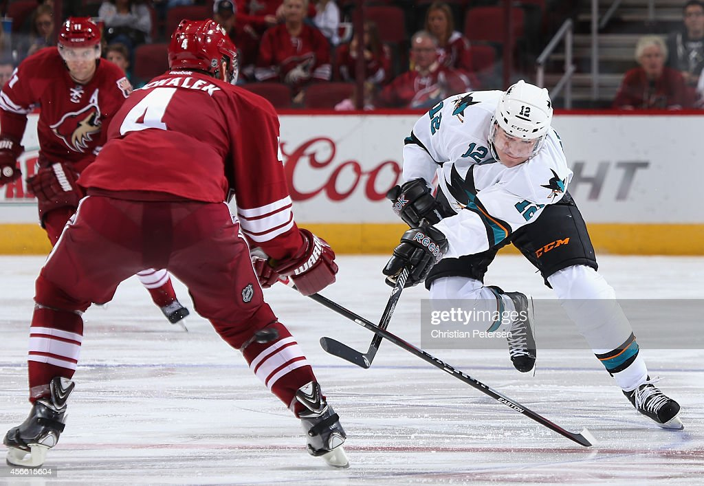 Patrick Marleau #12 of the San Jose Sharks shoots the puck past Zbynek Michalek #4 of the Arizona Coyotes during the third period of the preseason NHL game at Gila River Arena on October 3, 2014 in Glendale, Arizona. The Sharks defeated the Coyotes 3-1.