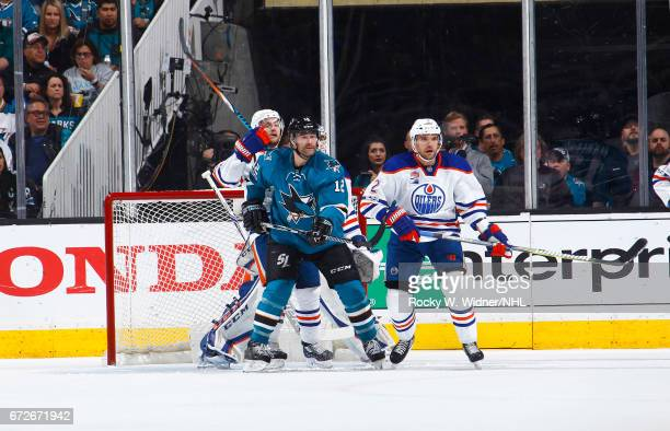 Patrick Marleau of the San Jose Sharks skates against Andrej Sekera of the Edmonton Oilers in Game Six of the Western Conference First Round during...