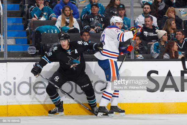 Patrick Marleau of the San Jose Sharks skates against Leon Draisaitl of the Edmonton Oilers at SAP Center on April 6 2017 in San Jose California