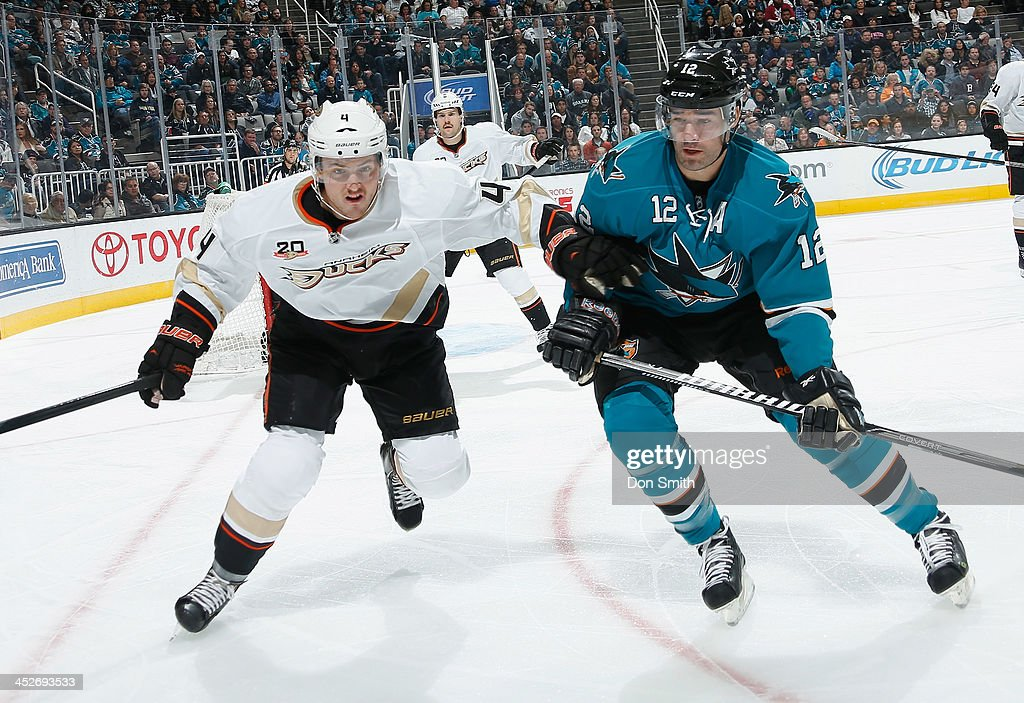 <a gi-track='captionPersonalityLinkClicked' href=/galleries/search?phrase=Patrick+Marleau&family=editorial&specificpeople=203165 ng-click='$event.stopPropagation()'>Patrick Marleau</a> #12 of the San Jose Sharks skates for the puck against <a gi-track='captionPersonalityLinkClicked' href=/galleries/search?phrase=Cam+Fowler&family=editorial&specificpeople=5484080 ng-click='$event.stopPropagation()'>Cam Fowler</a> #4 of the Anaheim Ducks during an NHL game on November 30, 2013 at SAP Center in San Jose, California.