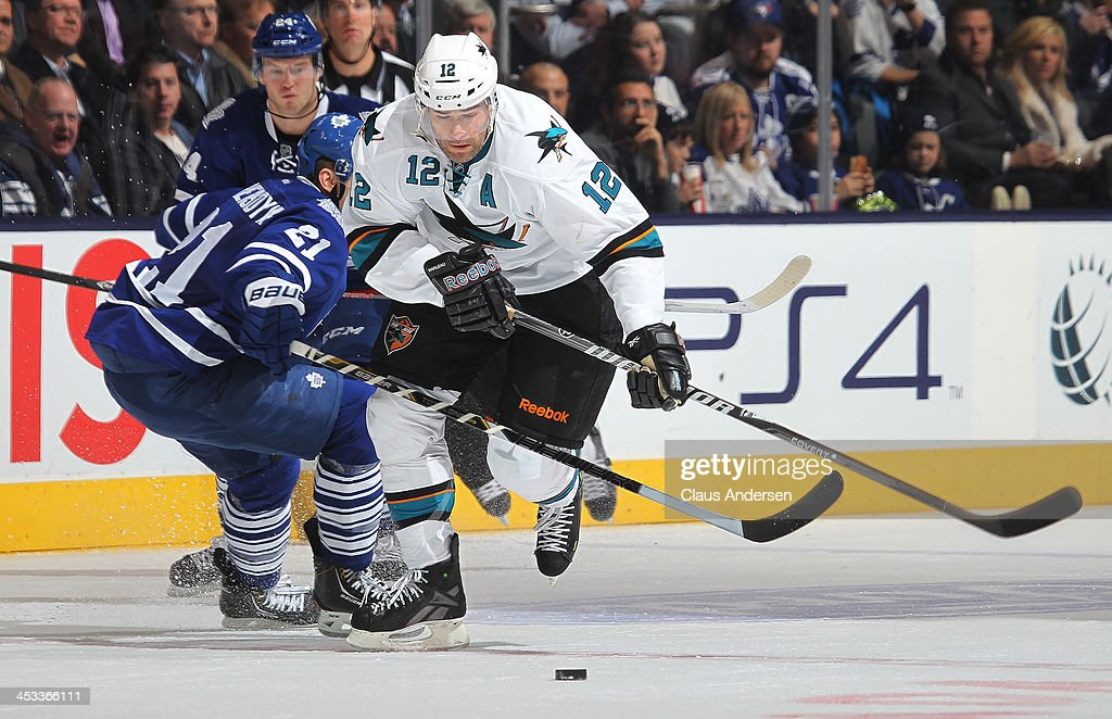 <a gi-track='captionPersonalityLinkClicked' href=/galleries/search?phrase=Patrick+Marleau&family=editorial&specificpeople=203165 ng-click='$event.stopPropagation()'>Patrick Marleau</a> #12 of the San Jose Sharks skates with the puck against the Toronto Maple Leafs during an NHL game at the Air Canada Centre on December 3, 2013 in Toronto, Ontario, Canada. The Sharks defeated the Leafs 4-2.