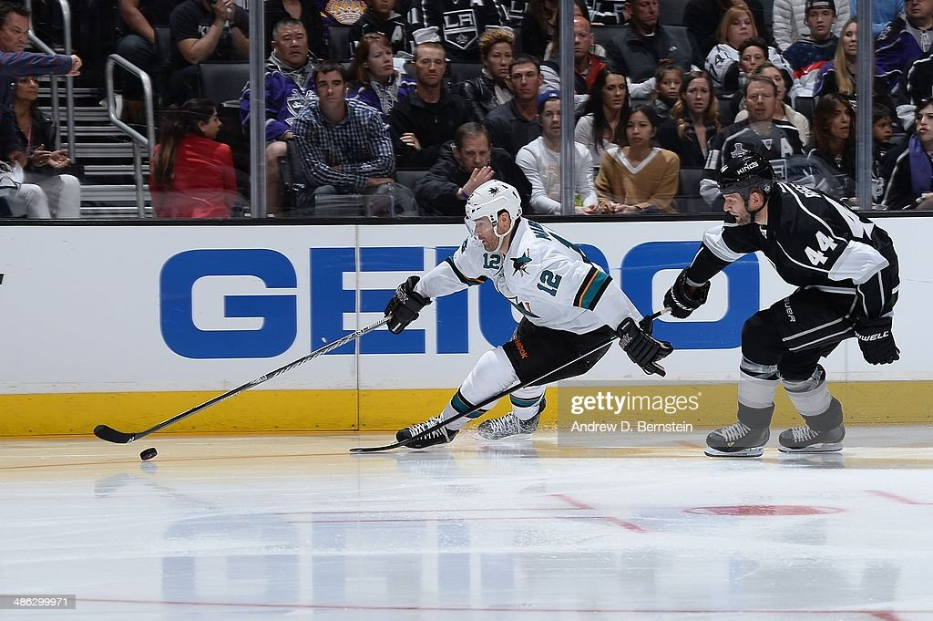 <a gi-track='captionPersonalityLinkClicked' href=/galleries/search?phrase=Patrick+Marleau&family=editorial&specificpeople=203165 ng-click='$event.stopPropagation()'>Patrick Marleau</a> #12 of the San Jose Sharks skates with the puck ahead of <a gi-track='captionPersonalityLinkClicked' href=/galleries/search?phrase=Robyn+Regehr&family=editorial&specificpeople=171828 ng-click='$event.stopPropagation()'>Robyn Regehr</a> #44 of the Los Angeles Kings in Game Three of the First Round of the 2014 Stanley Cup Playoffs at Staples Center on April 22, 2014 in Los Angeles, California.