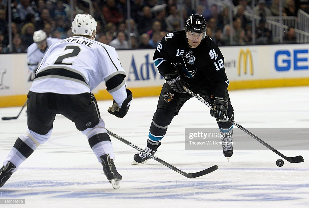 <a gi-track='captionPersonalityLinkClicked' href=/galleries/search?phrase=Patrick+Marleau&family=editorial&specificpeople=203165 ng-click='$event.stopPropagation()'>Patrick Marleau</a> #12 of the San Jose Sharks skates with the puck defended by <a gi-track='captionPersonalityLinkClicked' href=/galleries/search?phrase=Matt+Greene&family=editorial&specificpeople=536126 ng-click='$event.stopPropagation()'>Matt Greene</a> #2 of the Los Angeles Kings in the second period in Game Four of the Western Conference Semifinals during the 2013 NHL Stanley Cup Playoffs at HP Pavilion on May 21, 2013 in San Jose, California.