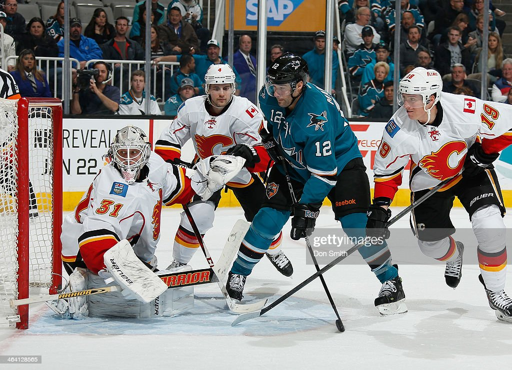<a gi-track='captionPersonalityLinkClicked' href=/galleries/search?phrase=Patrick+Marleau&family=editorial&specificpeople=203165 ng-click='$event.stopPropagation()'>Patrick Marleau</a> #12 of the San Jose Sharks tries to score against <a gi-track='captionPersonalityLinkClicked' href=/galleries/search?phrase=Karri+Ramo&family=editorial&specificpeople=716721 ng-click='$event.stopPropagation()'>Karri Ramo</a> #31, <a gi-track='captionPersonalityLinkClicked' href=/galleries/search?phrase=Kris+Russell&family=editorial&specificpeople=879805 ng-click='$event.stopPropagation()'>Kris Russell</a> #4 and Blair Jones #19 of the Calgary Flames during an NHL game on January 20, 2014 at SAP Center in San Jose, California.