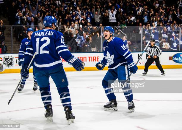 Patrick Marleau of the Toronto Maple Leafs celebrates his game winning overtime e goal on the Boston Bruins with teammate Mitch Marner at the Air...