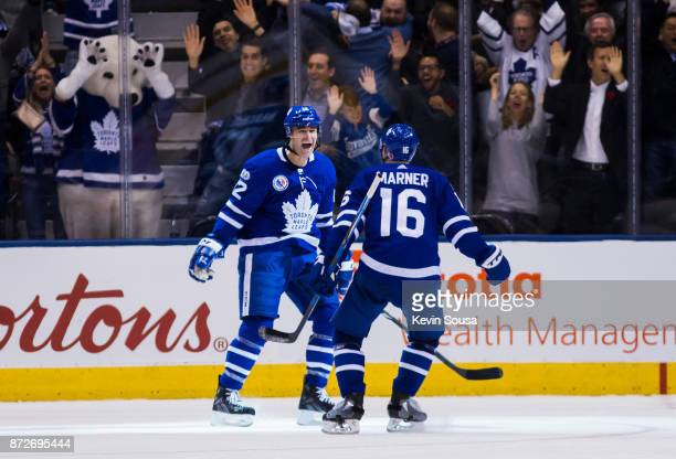 Patrick Marleau of the Toronto Maple Leafs celebrates his game winning overtime goal on the Boston Bruins with teammate Mitch Marner at the Air...
