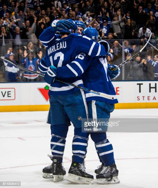 Patrick Marleau of the Toronto Maple Leafs celebrates his game winning overtime goal with teammates Mitch Marner and Jake Gardiner against the Boston...