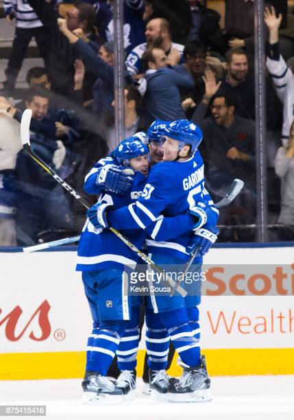 Patrick Marleau of the Toronto Maple Leafs celebrates his overtime goal against the Boston Bruins with teammates Mitchell Marner and Jake Gardiner at...