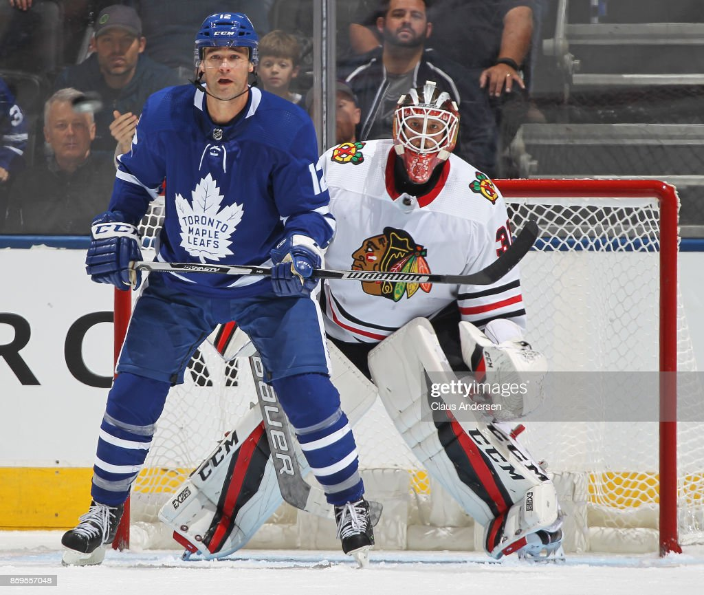 Patrick Marleau #12 of the Toronto Maple Leafs looks to tip a shot in front of Anton Forsberg #31 of the Chicago Blackhawks in an NHL game at the Air Canada Centre on October 9, 2017 in Toronto, Ontario. The Maple Leafs defeated the Blackhawks 4-3 in overtime