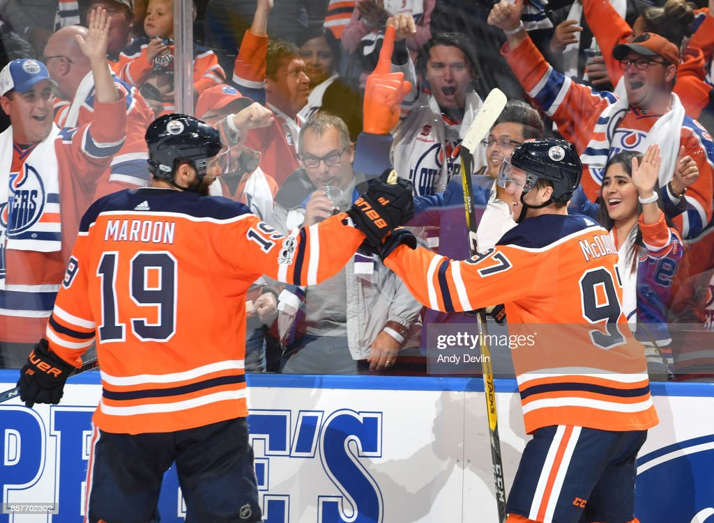Patrick Maroon #19 and Connor McDavid #97 of the Edmonton Oilers celebrate after a goal during the game against the Calgary Flames on October 4, 2017 at Rogers Place in Edmonton, Alberta, Canada.