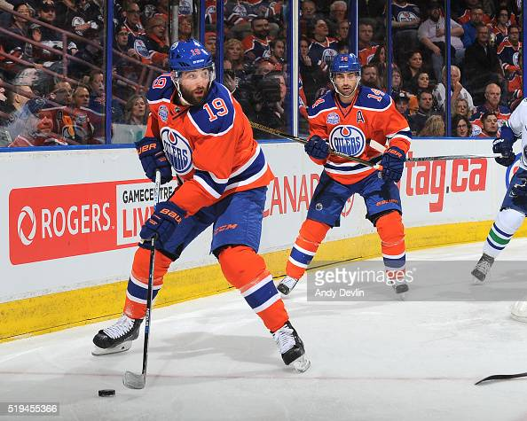 Patrick Maroon and Jordan Eberle of the Edmonton Oilers skate during a game against the Vancouver Canucks on April 6 2016 at Rexall Place in Edmonton...