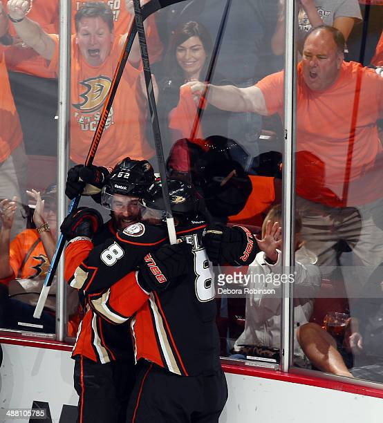 Patrick Maroon and Teemu Selanne of the Anaheim Ducks celebrate a goal scored by Selanne in the third period of Game One of the Second Round of the...
