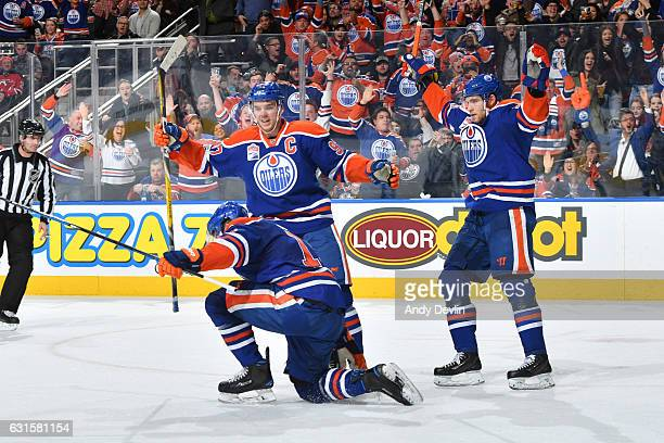 Patrick Maroon Connor McDavid and Leon Draisaitl of the Edmonton Oilers celebrate after a goal during the game against the New Jersey Devils on...