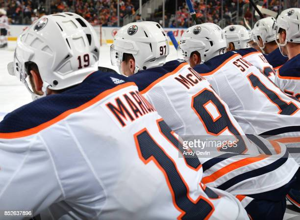 Patrick Maroon Connor McDavid and Ryan Strome of the Edmonton Oilers watch play from the bench during the preseason game against the Winnipeg Jets on...