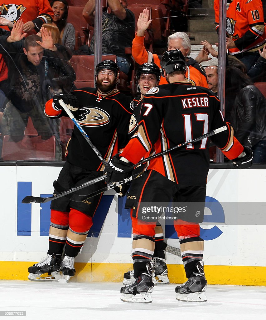 Patrick Maroon #19, David Perron #57 and Ryan Kesler #17 of the Anaheim Ducks celebrate a third period goal against the Arizona Coyotes on February 5, 2016 at Honda Center in Anaheim, California. The goal was later overturned after review.