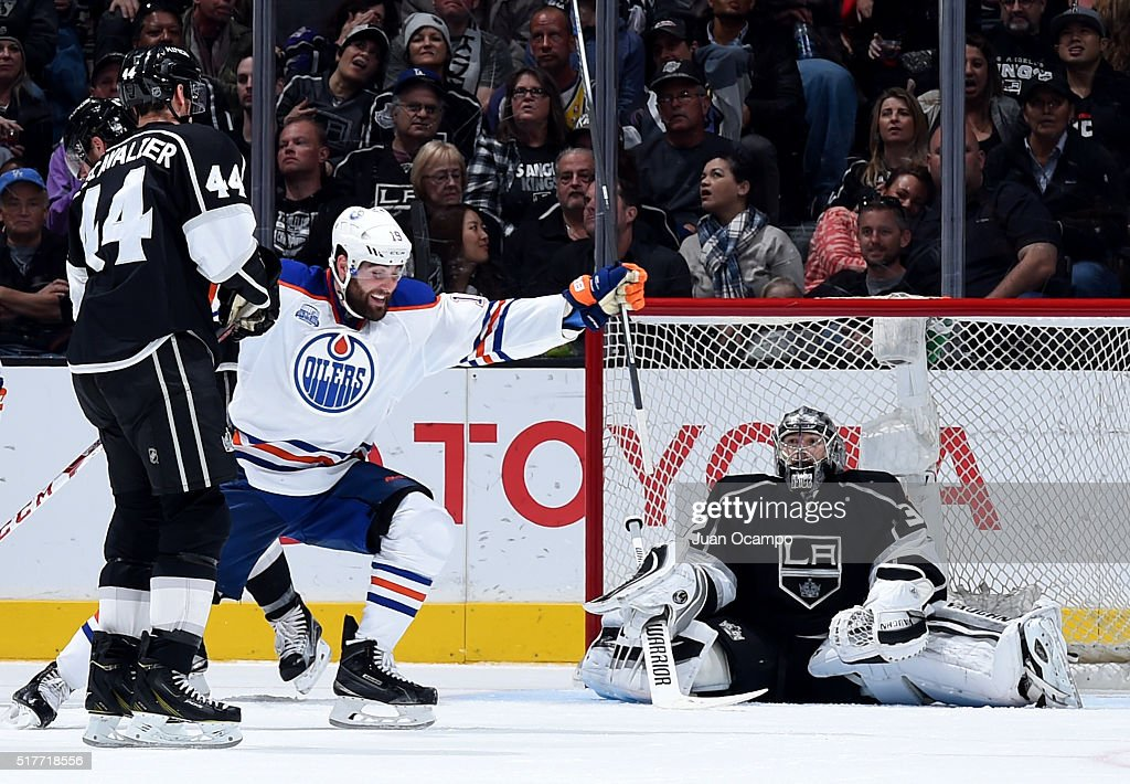 Patrick Maroon if the Edmonton Oilers celebrates his third period goal as Vincent Lecavalier and Jonathan Quick of the Los Angeles Kings look on...
