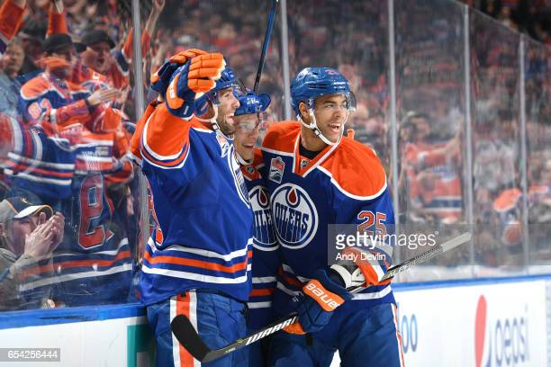 Patrick Maroon Matthew Benning and Darnell Nurse of the Edmonton Oilers celebrate after a goal during the game against the Boston Bruins on March 16...