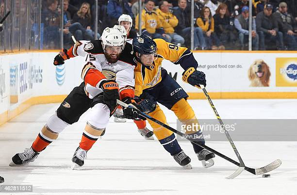 Patrick Maroon of the Anaheim Ducks battles for the puck against Filip Forsberg of the Nashville Predators during an NHL game at Bridgestone Arena on...