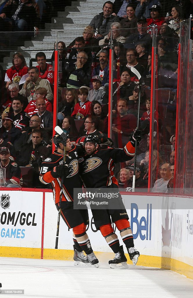 Patrick Maroon #62 of the Anaheim Ducks celebrates his first-period goal against the Ottawa Senators with teammate Ryan Getzlaf #15 at Canadian Tire Centre on October 25, 2013 in Ottawa, Ontario, Canada.