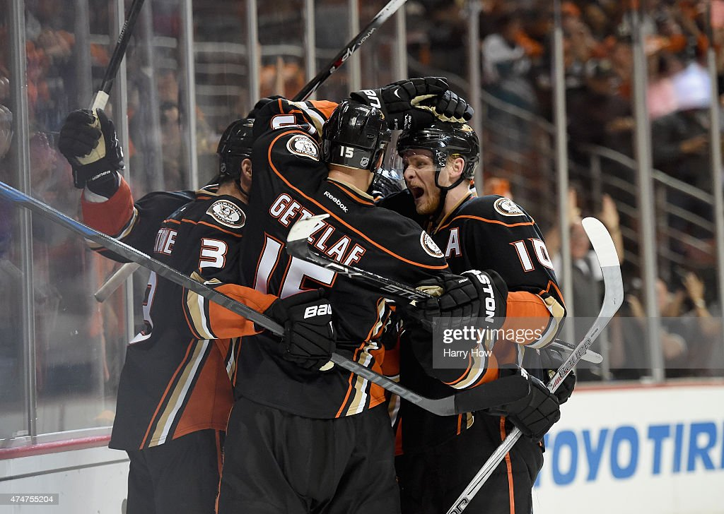 Patrick Maroon of the Anaheim Ducks celebrates scoring a goal with teammate Clayton Stoner Ryan Getzlaf Corey Perry and Sami Vatanen in the third...