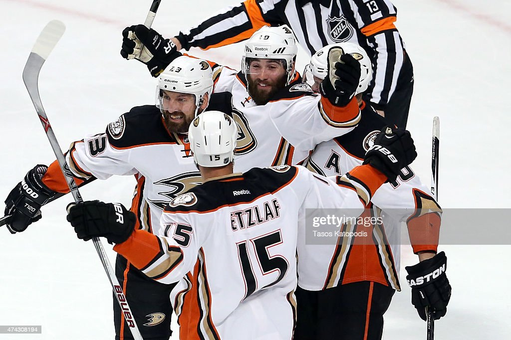 Patrick Maroon of the Anaheim Ducks celebrates with Francois Beauchemin and Ryan Getzlaf after scoring a first period goal against the Chicago...
