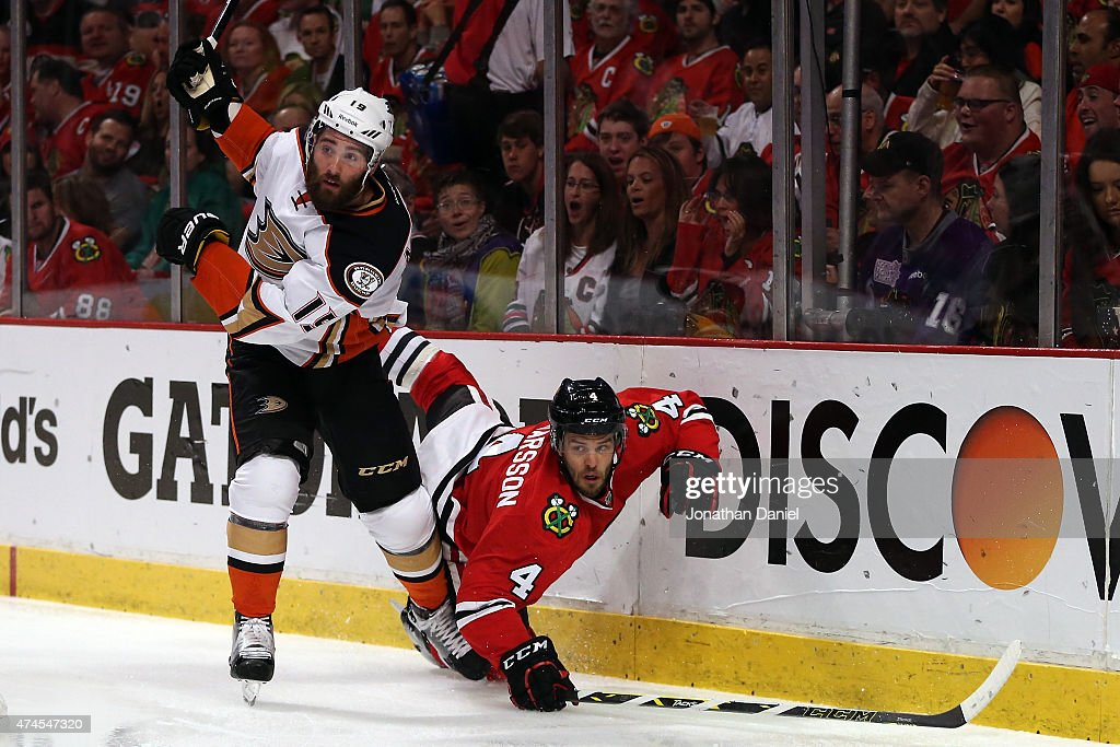 Patrick Maroon of the Anaheim Ducks checks Niklas Hjalmarsson of the Chicago Blackhawks in Game Four of the Western Conference Finals during the 2015...