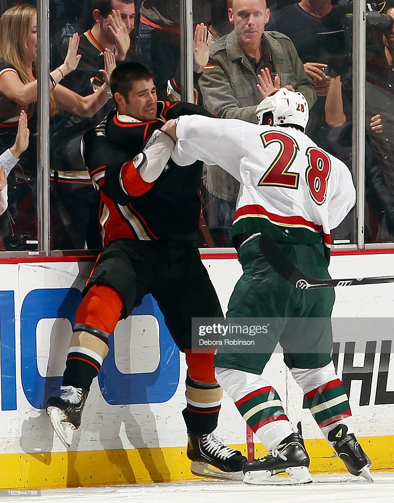 Patrick Maroon #62 of the Anaheim Ducks fights <a gi-track='captionPersonalityLinkClicked' href=/galleries/search?phrase=Zenon+Konopka&family=editorial&specificpeople=2105876 ng-click='$event.stopPropagation()'>Zenon Konopka</a> #28 of the Minnesota Wild on March 1, 2013 at Honda Center in Anaheim, California.