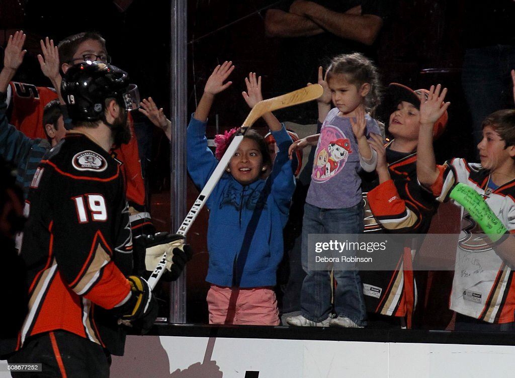 Patrick Maroon #19 of the Anaheim Ducks gets set to give his game used stick to a young fan after the Ducks' 5-2 win against the Arizona Coyotes on February 5, 2016 at Honda Center in Anaheim, California.
