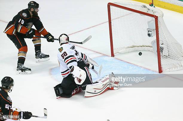 Patrick Maroon of the Anaheim Ducks gets the puck past goaltender Corey Crawford of the Chicago Blackhawks to score in the third period of Game Five...