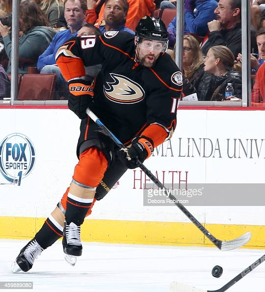 Patrick Maroon of the Anaheim Ducks handles the puck against the Chicago Blackhawks on November 28 2014 at Honda Center in Anaheim California