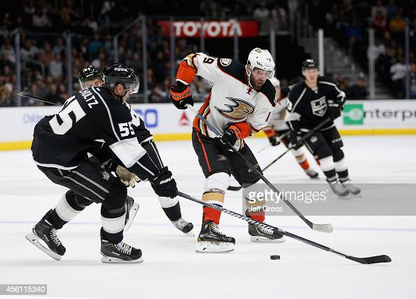 Patrick Maroon of the Anaheim Ducks is defended by Jeff Schultz of the Los Angeles Kings in the third period at Staples Center on September 25 2014...