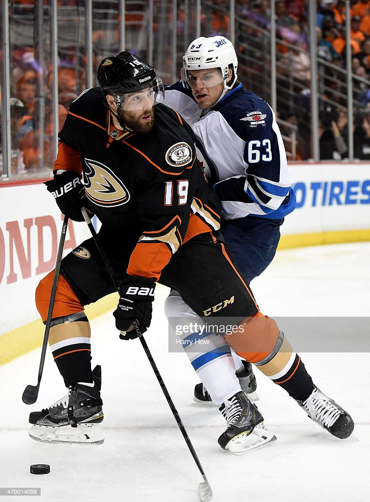 Patrick Maroon of the Anaheim Ducks looks to pass as he is checked by Ben Chiarot of the Winnipeg Jets during the first period in Game One of the...