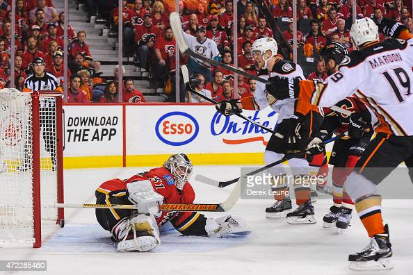 Patrick Maroon of the Anaheim Ducks scores against Karri Ramo of the Calgary Flames in Game Three of the Western Conference Semifinals during the...