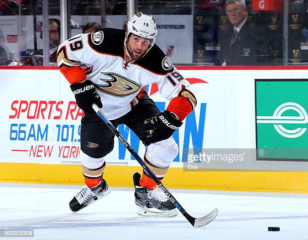 Patrick Maroon of the Anaheim Ducks takes the puck in the third period against the New Jersey Devils on December 19 2015 at Prudential Center in...