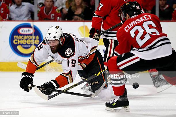 Patrick Maroon of the Anaheim Ducks tries to control the puck as Kyle Cumiskey of the Chicago Blackhawks defends in the first period of Game Six of...