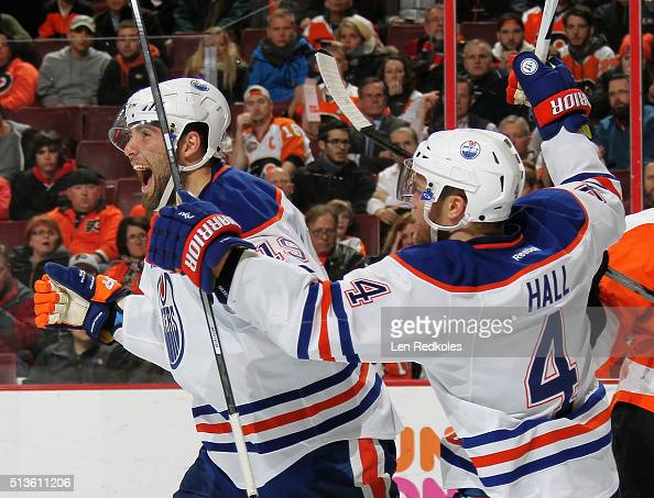 Patrick Maroon of the Edmonton Oilers celebrates his second period goal against the Philadelphia Flyers with teammate Taylor Hall on March 3 2016 at...