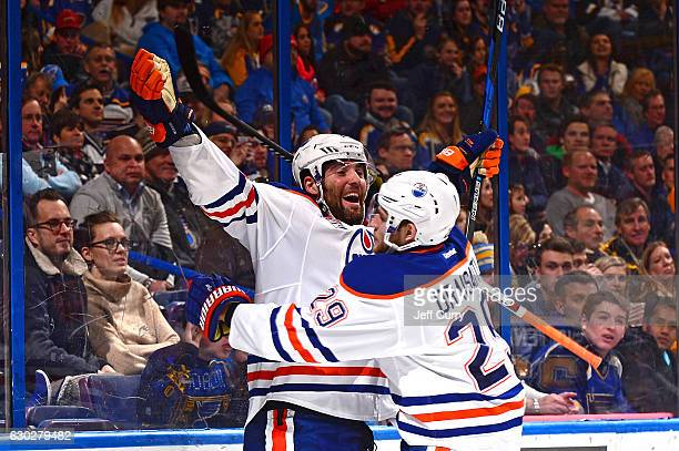 Patrick Maroon of the Edmonton Oilers is congratulated by Leon Draisaitl after scoring the game tying goal against the St Louis Blues on December 19...