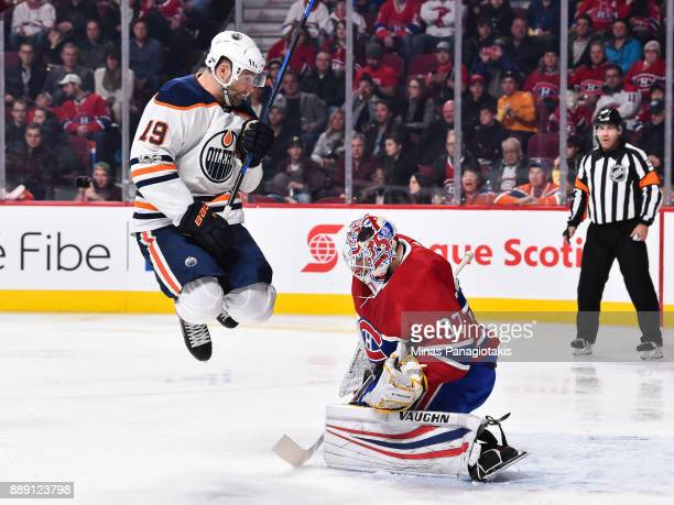 Patrick Maroon of the Edmonton Oilers jumps in front of goaltender Antti Niemi of the Montreal Canadiens during the NHL game at the Bell Centre on...